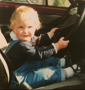 Me, showing early driving abilities.